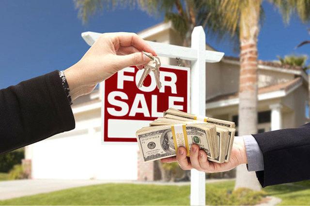 Когда отдавать деньги при покупке земельного участка